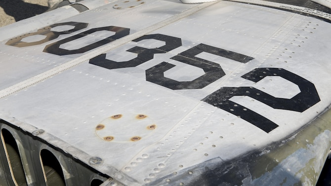 """The tail markings on the tail section of the Fairchild C-119B Flying Boxcar #48-0352 """"Am Can Co Special"""" Dec. 17, 2016, at Edwards Air Force Base, Calif. C-119s were built at Fairchild's Hagerstown, Md. Factory. (U.S. Air Force photo by Senior Airman Zachary Cacicia)"""