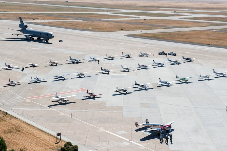 Civilian aircraft are parked on the tarmac at Travis Air Force Base, Calif. Local pilots were invited to attend the Travis Air Force Base Mid-Air Collision Avoidance (MACA) fly-in event. The purpose of the event is to promote safe air operations and strengthen the relationship with civil aviation pilots who frequently transit in and around Travis Air Force Base airspace. The 60th Air Mobility Wing safety office provided more than 35 pilots and 70 guests with a full day of activities to include a tour of air traffic control tower, C-5M Super Galaxy, and a KC-10 Extender, Jun. 25, 2016. (U.S. Air Force photo by Louis Briscese/Released)
