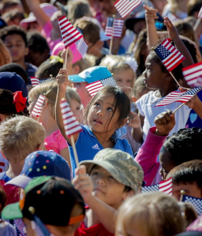 Over 1,000 attendees to include students, parents, faculty and volunteers from the Travis Unified School District participated in the America Supports You Freedom Walk, Sept. 9, 2016, Travis Air Force Base, Calif. Participants met at the Airman and Family Readiness Center to read poems, listen to speeches and patriotic music. The event is a national tradition to reflect on the lives lost on Sept. 11, 2001, remember those who responded, honor our veterans past and present, and renew our commitment to freedom and the values of our country. (U.S. Air Force Photo by Heide Couch)