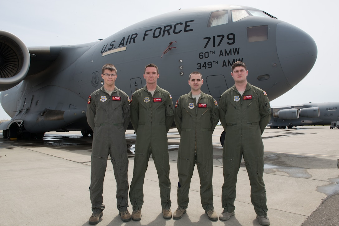 From left, U.S. Air Force Airman 1st Class Austen Copeland, Capt. Eric Rieboldt, Capt. Grant Hadley, and Senior Airman Max Oldroyd, assigned to the 21st Airlift Squadron, Travis Air Force Base, Calif., pose for a group picture on the flight line in front of a C-17 Globemaster III. The aircrew evacuated injured Americans from the terrorist attacks in Brussels, Belgium, not pictured are U.S. Air Force 1st Lt. Justin Gross and Staff Sgt. Chase Decker, April 26, 2016 (U.S. Air Force photo by Louis Briscese/Released)