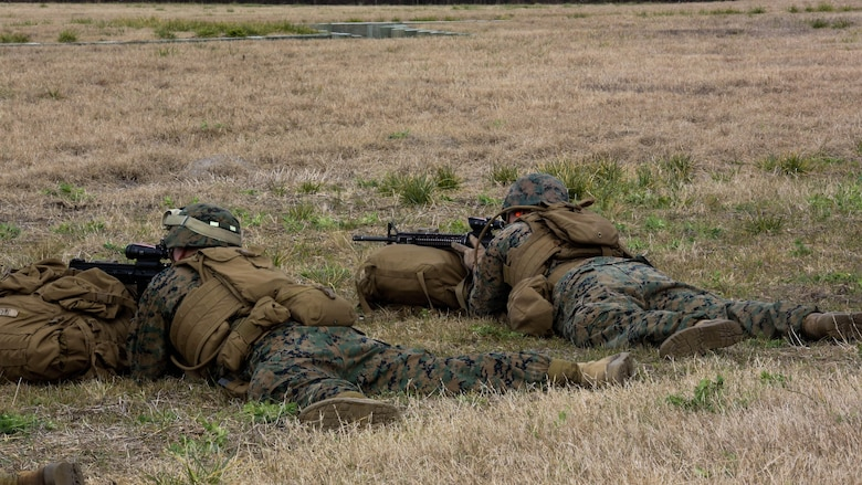 Marines with Company F, 2nd Battalion, 8th Marine Regiment, assault targets down range during a field exercise at Marine Corps Base Camp Lejeune, N.C., Jan. 28, 2016. Marines focused on individual marksmanship in preparation for a squad attack.