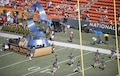 "Military volunteers help set up the 2016 NFL Pro Bowl pregame show stage at Aloha Stadium in Honolulu, Jan. 31, 2016. More than 200 military volunteers worked together to construct the pregame show stage in support of Rachel Platten's performance of her song ""Fight Song."" The U.S. military also conducted a C-17 Globemaster flyover and U.S. Pacific Command leadership participated in the game's coin toss. DoD photo by Staff Sgt. Christopher Hubenthal"