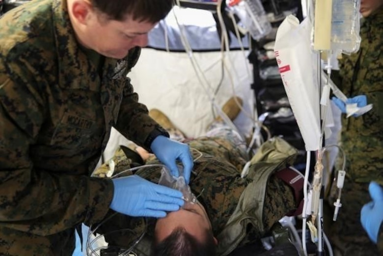 Petty Officer 2nd Class Derek McCarthy, a corpsman with 2nd Medical Battalion, treats a role-player for injuries in preparation for their upcoming multinational exercise, Cold Response 16.1, in Norway.at Camp Lejeune, N.C, Jan. 28, 2016.  The corpsmen treated injuries they will encounter in the cold weather climate they will experience in Norway.  (U.S. Marine Corps photo by Cpl. Michael Dye/Released)