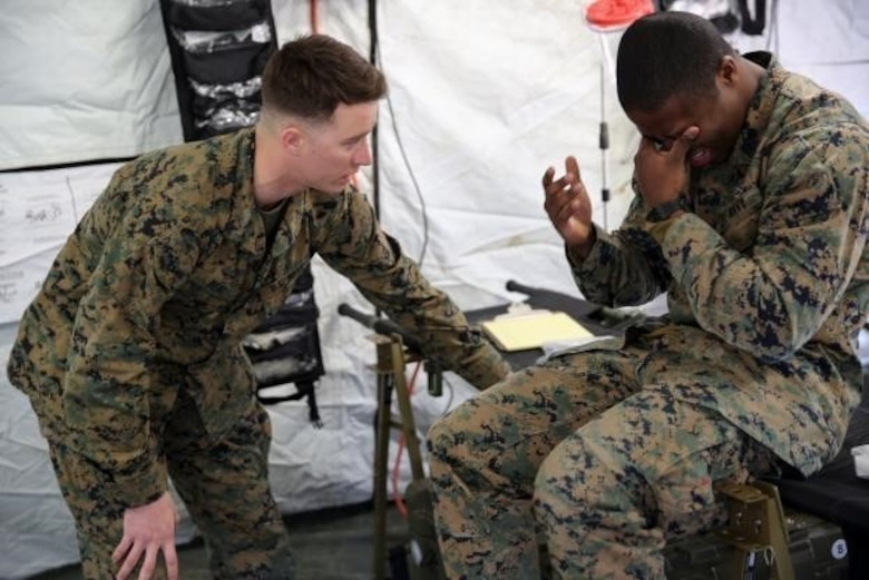 Petty Officer 3rd Class Matthew Beal, left, a corpsman with 2nd Medical Battalion, treats a role-player for injuries in preparation for the upcoming multinational exercise, Cold Response 16.1, in Norway, at Camp Lejeune, N.C, Jan. 28, 2016.  The corpsmen treated injuries mainly pertaining to the cold weather climate they will be experiencing in Norway.  (U.S. Marine Corps photo by Cpl. Michael Dye)