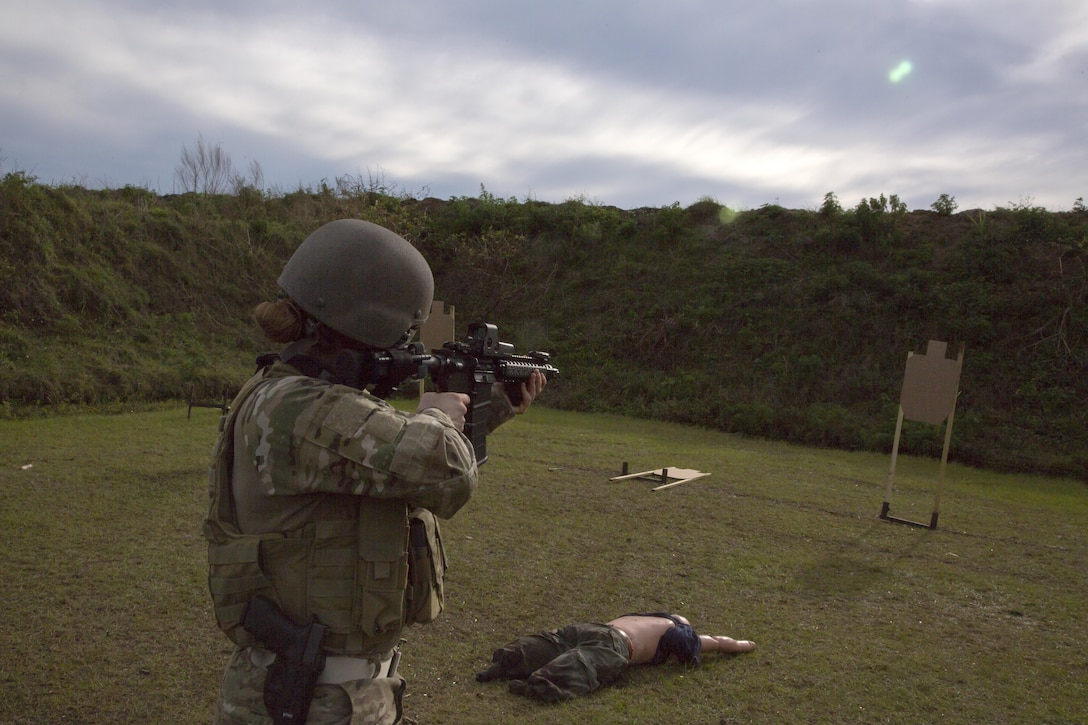 A U.S. Army Soldier from the 982nd Combat Camera Company (Airborne), East Point, Ga., fires at a simulated target in order to provide combat lifesaving measures to a casualty, as her secondary mission of her primary (combat) mission during a Tactical Combat Casualty Care (TCCC) training exercise during a two-day certification held at OK Gun Corral Club, Okeechobee, Fla., Jan. 30, 2016. The combat lifesaver is trained to provide immediate care that can save a casualty's life, such as stopping severe bleeding, administering intravenous fluids to control shock and performing needle chest decompression for a casualty with tension pneumothorax. TCCC introduces evidence-based, life-saving techniques and strategies for providing the best trauma care on the battlefield. (U.S. Army photo by Spc. Tracy McKithern/Released)