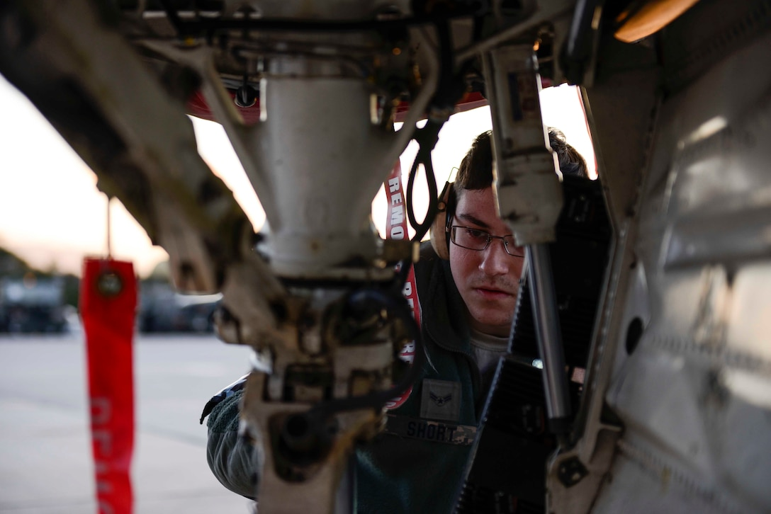 Airman 1st Class Samuel Short, a crew chief assigned to the 480th Expeditionary Fighter Squadron, inspects the front wheel assembly of an F-16 Fighter Falcon during a flying training deployment on the flightline at Souda Bay, Greece, Jan. 27, 2016. Approximately 300 personnel and 18 F-16s from the 52nd Fighter Wing at Spangdahlem Air Base, Germany, supported flight during the FTD as part of U.S. Air Forces in Europe-Air Forces Africa's Forward Ready Now stance. (U.S. Air Force photo/Staff Sgt. Christopher Ruano)