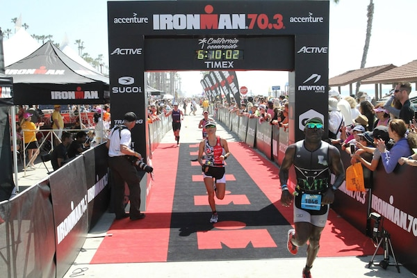 Marine Corps Staff Sgt. Kenneth Bell, right, finishes the 2015 Ironman 70.3 SuperFrog triathlon event in Coronado, Calif., Sept. 27, 2015. Bell, a helicopter mechanic with Headquarters Co., I Marine Expeditionary Force Headquarters Group, has participated in more than 25 major endurance training competitions. Courtesy Photo