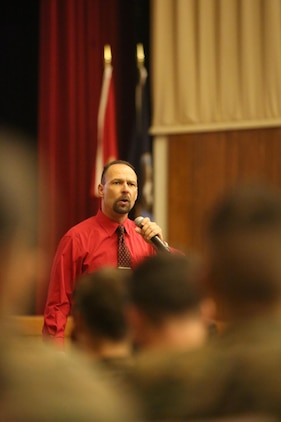 More than 200 Marines with Combat Logistics Regiment 25 filled the base theater to listen to motivational speaker Todd Parisi at Camp Lejeune, N.C., Jan. 28, 2016. Parisi, a former Sgt. Maj. with 28 years of service to the Marine Corps, now travels talking to groups of civilians and service members. (U.S. Marine Corps photo by LCpl. Miranda Faughn/Released)