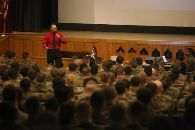 """More than 200 Marines with Combat Logistics Regiment 25 filled the base theater to listen to motivational speaker Todd Parisi at Camp Lejeune, N.C., Jan. 28, 2016. Parisi emphasized, like everything in the Marine Corps, respect is earned. """"Regardless of rank, Marines will loan you respect as one Marine to another, but after a while that has to be earned too,"""" said Parisi. (U.S. Marine Corps photo by LCpl. Miranda Faughn/Released)"""