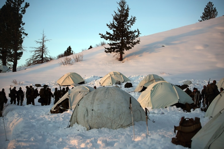 Marines with Combat Logistics Battalion 252 prepare for the day outside of their tents in the mountains of Bridgeport, Calif., during Mountain Exercise 1-16, a cold weather training exercise, on Jan. 12, 2016. The training is a prerequisite for a large, multi-national exercise called Cold Response 16 that will take place in Norway, March of this year. Cold Response will challenge 12 NATO allies' and partners' abilities to work together and respond in the case of a crisis. (U.S. Marine Corps photo by Lance Cpl. Brianna Gaudi/released)