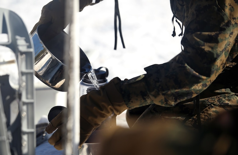 A Marine with Combat Logistics Battalion 252 pours purified water into a bottle in the mountains of Bridgeport, Calif,. during Mountain Exercise 1-16, a cold weather training exercise, on Jan. 12, 2016. The training is a prerequisite for a large, multi-national exercise called Cold Response 16 that will take place in Norway, March of this year. Cold Response will challenge 12 NATO allies' and partners' abilities to work together and respond in the case of a crisis. (U.S. Marine Corps photo by Lance Cpl. Brianna Gaudi/released)