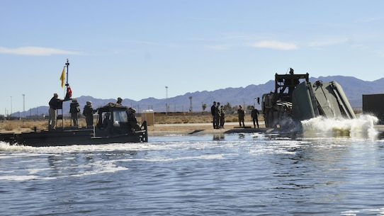 Marines with 7th Engineer Support Battalion test Improved Ribbon Bridge components with representatives from Marine Corps Systems Command, and Marine Corps Engineer School, at the test pond aboard Marine Corps Logistics Base Barstow's Yermo Annex, Calif., Jan. 25. Function checks are performed on the IRB before it is sent to the Operating Forces in order to ensure that they receive properly working equipment, said Gunnery Sgt. Quinton Shearer, Bridging Project Officer with Marine Corps Systems Command.