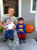 Army Capt. Eileen Hernandez, a public affairs officer with 1st Calvary Division's 2nd Armored Brigade Combat Team at Fort Hood, Texas, awaits trick-or-treaters at home with two of her sons, Oct. 31, 2014. Hernandez said she is filled with gratitude and hope as a result of Defense Secretary Ash Carter's decision to expand maternity leave to 12 weeks. Courtesy photo by Ernesto Hernandez