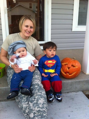 Army Capt. Eileen Hernandez, a public affairs officer with 1st Cavalry Division's 2nd Armored Brigade Combat Team at Fort Hood, Texas, awaits trick-or-treaters at home with two of her sons, Oct. 31, 2014. Hernandez said she is filled with gratitude and hope as a result of Defense Secretary Ash Carter's decision to grant 12 weeks of maternity leave to service members as part of his Force of the Future initiative. Courtesy photo by Ernesto Hernandez
