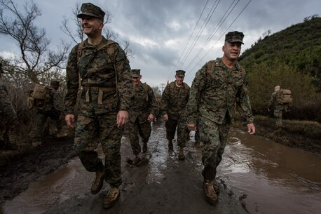 U.S. Marine Corps Maj. Gen. Daniel O'Donohue, left, commanding general, 1st Marine Division, and Col. Paul Nugent, right, commanding officer, Headquarters Battalion, 1st Marine Division, lead a conditioning hike at Marine Corps Base Camp Pendleton, Calif., Jan. 7, 2016. Headquarters Battalion conducted a conditioning hike to maintain combat and physical fitness standards. (U.S. Marine Corps Combat Camera photograph by Lance Cpl. Adrianna R. Lincoln/RELEASED)