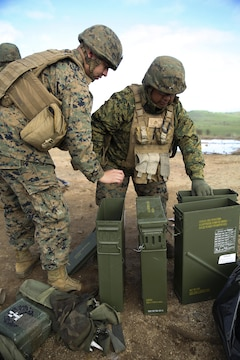 Cpl. Juan Castillo, Jr. (left) and Lance Cpl. Jorge Peralta Roman, mortarmen with 2nd Battalion, 23rd Marine Regiment, 4th Marine Division, inspect mortar rounds during a call-for-fire joint-training exercise with 6th Air Naval Gunfire Liaison Company, Force Headquarters Group, Jan. 23, 2016 at Camp Roberts, Calif. The Marines of 6th ANGLICO conducted call-for-fire exercises and machine gun ranges alongside mortar platoons from 2/23 to complete comprehensive live-fire training.
