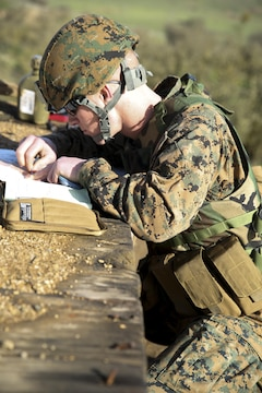 Lance Cpl. Daniel Womack, a forward observer with 6th Air Naval Gunfire Liaison Company, Force Headquarters Group, calculates target trajectory and distance to receive fire from mortars Jan. 23, 2016 at Camp Roberts, Calif. The Marines of 6th ANGLICO conducted call-for-fire exercises and machine gun ranges alongside mortar platoons from 2/23 to complete comprehensive live-fire training.