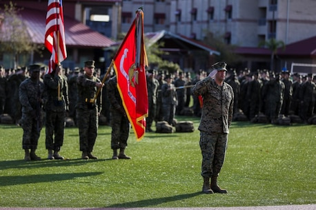 U.S. Marine Corps Col. Paul J. Nugent, commanding officer, Headquarters Battalion, 1st Marine Division, relinquishes command to Lt. Col. Michael Nakonieczny during a change of command ceremony at Marine Corps Base Camp Pendleton, Calif., Jan. 7, 2016. A change of command is a military tradition that represents a formal transfer of authority and responsibility for a unit from one commanding officer to another. (U.S. Marine Corps photo by Lance Cpl. Nathaniel Castillo, 1st Marine Division Combat Camera/Released)
