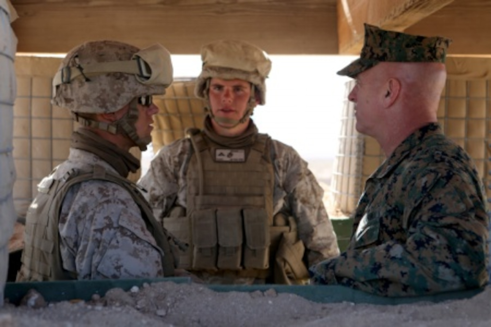 Brigadier General David A. Ottignon, 1st Marine Logistics Group Commanding General, speaks with Lance Cpl. Frederick Vaca and Lance Cpl. Landon Brown, combat engineers with Combat Logistics Battalion 5, about how they can positively affect their unit by training hard and excelling in their job. Ottignon visited several MLG units aboard Marine Corps Air Ground Combat Center Twentynine Palms, Calif., on Jan. 26-27, 2016, to speak with unit commanders as well as engage junior Marines and Non-Commissioned officers to get sense of how the units were doing and what areas could be improved upon.