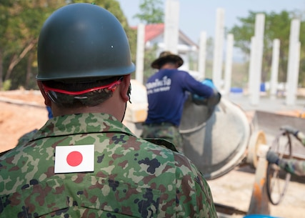 A member of the 105th Engineer Unit, Engineer Unit, North Army, Japan Ground Self-Defense Force, watches as a Royal Thai Navy sailor pours water into a cement mixing cylinder Jan. 27, at the Ban Cham Kho humanitarian civic action site, Rayong, Thailand. The construction at Ban Cham Kho is one of six HCA sites in which the Thai, U.S. and partner nation's militaries will work together on civic programs during Cobra Gold 2016. Cobra Gold, in its 35th iteration, demonstrates the commitment of the Kingdom of Thailand and the U.S. to our long-standing alliance and regional partnership toward advancing prosperity and security in the Asia-Pacific region.