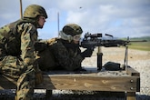 Lance Cpl. Ethan Evans (left), a motor transport mechanic with 6th Air Naval Gunfire Liaison Company, Force Headquarters Group, instructs Lance Cpl. Jacob Levy, a ground electronic maintenance technician with 6th ANGLICO, on the M249 squad automatic weapon range Jan 23, 2016 at Camp Roberts, California. The Marines of 6th ANGLICO conducted call-for-fire exercises and machine gun ranges alongside mortar platoons from 2nd Battalion, 23rd Marine Regiment, 4th Marine Division, to complete comprehensive live-fire training.