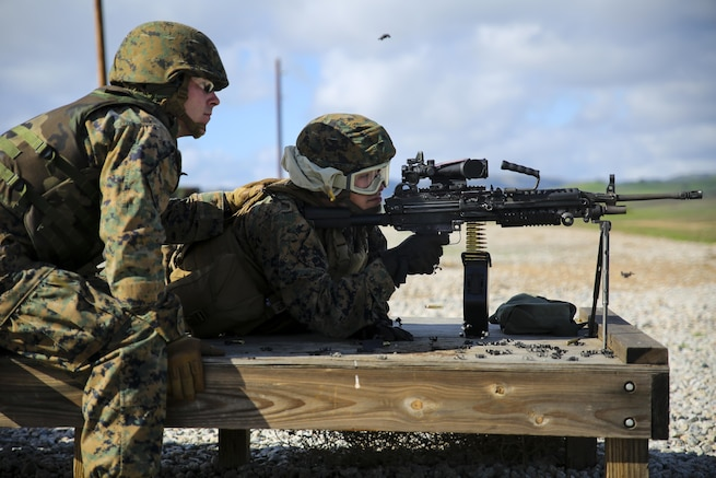 Marine Corps Lance Cpl. Ethan Evans, left, instructs Lance Cpl. Jacob Levy on firing an M249B light machine gun during comprehensive live-fire training on Camp Roberts, Calif., Jan 23, 2016. The Marines are assigned to the 6th Air Naval Gunfire Liaison Company. Marine Corps photo by Cpl. Tiffany Edwards