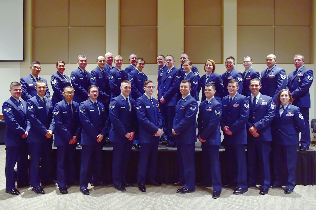 Team Buckley members were promoted to their next ranks Jan. 29, 2016, at the Leadership Development Center on Buckley Air Force Base, Colo. A promotion ceremony is a time-honored tradition in the Air Force, allowing co-workers, family and friends to support and congratulate Airmen on their promotion. (U.S. Air Force photo by Airman 1st Class Luke W. Nowakowski/Released)