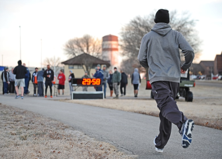 A member of Team Whiteman races to the finish line during the Resolution 5k run at Whiteman Air Force Base, Mo., Jan. 29, 2016. The Whiteman 5k is sponsored monthly by the Whiteman Tier II and gives base residents an opportunity to come together as a community, promoting health and fitness. (U.S. Air Force photo by Tech. Sgt. Miguel Lara III)