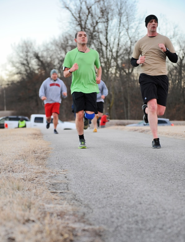 Members of Team Whiteman run toward the finish line during the Resolution 5k run at Whiteman Air Force Base, Mo., Jan. 29, 2016. An information expo was held after the run with representatives from the education office, physical therapy, mental health/ADAPT, the Chaplain Corps, health promotion director and the fitness center staff. The support agencies provided individuals with guidance to help reach their 2016 goal. (U.S. Air Force photo by Tech. Sgt. Miguel Lara III)