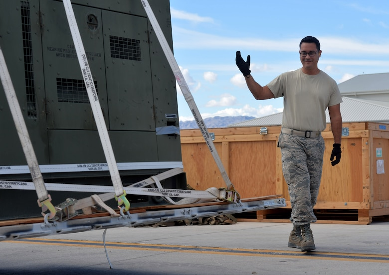 Tech. Sgt. Nicholas, 432nd Maintenance Squadron Aerospace Ground Equipment craftsman, loads pallets to be shipped to a deployment location Oct. 6, 2015, at Creech Air Force Base, Nevada. The 432nd AGE shop has recently achieved an above average passing rate of 95 percent, the highest that the shop has seen yet. The average passing rate for a typical AGE shop in the Air Force is about 85 percent. (U.S. Air Force photo by Senior Airman Christian Clausen/Released)