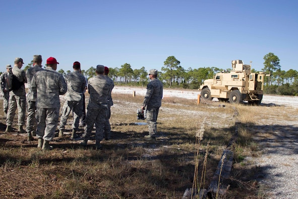Workshop participants view a recovery of airbases denied by ordnance, or RADBO vehicle, a ZEUS III laser integrated to a CAT1/A1 mine resistant ambush protected, during the unexploded explosive ordnance mitigation workshop held Dec. 8, 2015, at the Air Force Civil Engineer Center Research Lab at Tyndall Air Force Base, Florida.