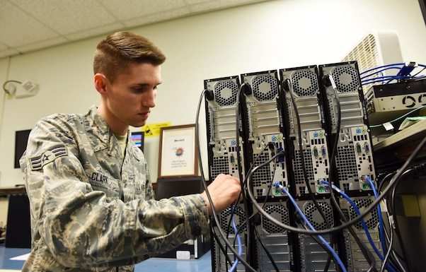Senior Airman Travis Clark, 188th Communications Flight Focal Point, connects desktop computers to the network domain at Ebbing Air National Guard Base, Fort Smith, Ark., Dec. 6, 2015. Clark has been selected as the Flying Razorback Spotlight for February 2016. (U.S. Air National Guard photo by Senior Airman Cody Martin/Released)