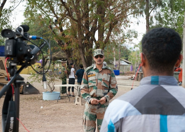 Indian Army Maj. Kuldeet Gautam, Bengal Engineering Group and Center, Corps of Engineers, Indian Army, is interviewed during the Ban Raj Bum Roong school construction project Jan. 30 at Lamsonthi, Kuttaphet, Thailand. The construction at Ban Raj Bum Roong is one of six HCA sites in which the Thai, U.S. and partner nation's militaries will work together on civic programs during Cobra Gold 2016. Cobra Gold, in its 35th iteration, demonstrates the commitment of the Kingdom of Thailand and the U.S. to our long-standing alliance and regional partnership toward advancing prosperity and security in the Asia-Pacific region.  (U.S. Marine Corps photo by Staff Sgt. Jose O. Nava/Released)