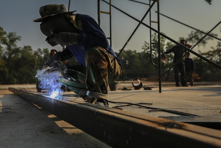 Royal Thai Navy Seaman Manut Puckhago welds a support beam during the building of a multi-purpose room for the Banchamkho school during exercise Cobra Gold 2016 in Rayong, Kingdom of Thailand, Jan. 30, 2016. Cobra Gold 2016, in its 35th iteration, includes a specific focus on Humanitarian Civic Action, community engagement, and medical activities conducted during the exercise to support the needs and humanitarian interests of civilian populations around the region.