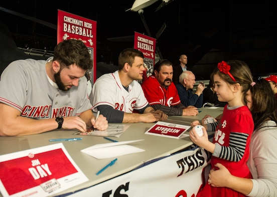National Museum of the U.S. Air Force visitors had the opportunity to meet members of the Cincinnati Reds organization on January 30th, 2016. Here minor league pitcher Cody Reed signs his autograph for a fan. Also pictured are catcher Devin Mesoraco, former catcher Corky Miller, and president of baseball operations Walt Jocketty. (U.S. Air Force photo)