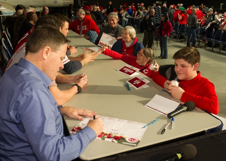 National Museum of the U.S. Air Force visitors had the opportunity to meet members of the Cincinnati Reds organization on January 30th, 2016. Here a fan receives and autograph from broadcaster Jim Day. Catcher Devin Mesoraco; president of baseball operations Walt Jocketty; minor league pitcher Cody Reed; former catcher Corky Miller; owner Bob Castellini; chief operating officer Phil Castellini; Baseball Hall of Famer Joe Morgan; broadcaster Thom Brennaman and mascot Mr. Redlegs were also at the museum stop. (U.S. Air Force photo)