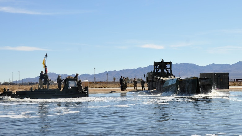 Marines with 7th Engineer Support Battalion from Marine Corps Base Camp Pendleton, Calif., test Improved Ribbon Bridge components with representatives from Marine Corps Systems Command, and Marine Corps Engineer School, at Production Plant Barstow's test pond aboard Marine Corps Logistics Base Barstow's Yermo Annex, Calif., Jan. 25, 2016