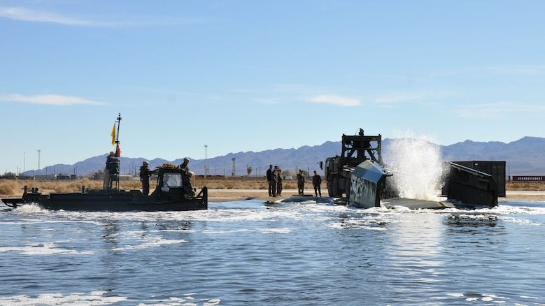 Marines with 7th Engineer Support Battalion from Marine Corps Base Camp Pendleton, Calif., test Improved Ribbon Bridge components with representatives from Marine Corps Systems Command, and Marine Corps Engineer School, at Production Plant Barstow's test pond aboard Marine Corps Logistics Base Barstow's Yermo Annex, Calif., Jan. 25, 2016.