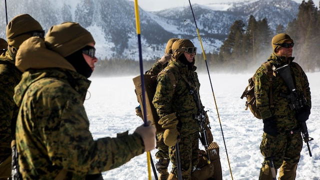 Marines listen to an avalanche probe pole class in the mountains of Bridgeport, California, during Mountain Exercise 1-16, a cold weather training exercise, on Jan. 13, 2016. The training is a prerequisite for a large, multi-national exercise called Cold Response 16 that will take place in Norway, March of this year. Cold Response will test 12 NATO allies' and partners' abilities to work together and respond in the case of a crisis.