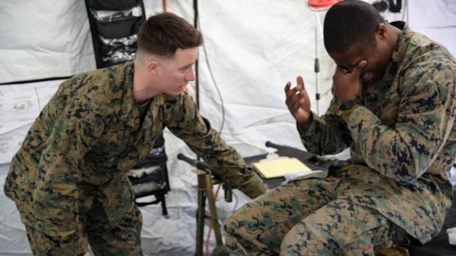 Petty Officer 3rd Class Matthew Beal, left, a corpsman with 2nd Medical Battalion, treats a role-player for injuries in preparation for the upcoming multinational exercise, Cold Response 16.1, in Norway, at Marine Corps Base Camp Lejeune, N.C, Jan. 28, 2016.  The corpsmen treated injuries mainly pertaining to the cold weather climate they will be experiencing in Norway.