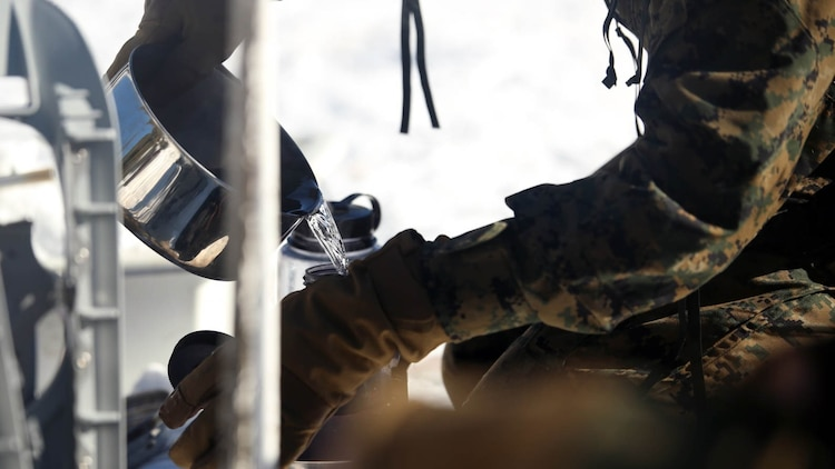 A Marine with Combat Logistics Battalion 252 pours purified water into a bottle in the mountains of Bridgeport, California, during Mountain Exercise 1-16, a cold weather training exercise, on Jan. 12, 2016. The training is a prerequisite for a large, multi-national exercise called Cold Response 16 that will take place in Norway, March of this year. Cold Response will challenge 12 NATO allies' and partners' abilities to work together and respond in the case of a crisis.
