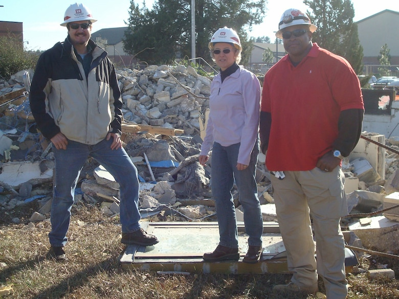 Bryan Smith, a quality assurance representative for the Savannah District, left; Lynn Daniels, Engineering and Support Center, Huntsville virtual project manager; and Amos Persaved, NorthStar employee, conduct demolition work for the Huntsville Center's Facilities Reduction Program at Fort Bragg, North Carolina, Jan. 16.