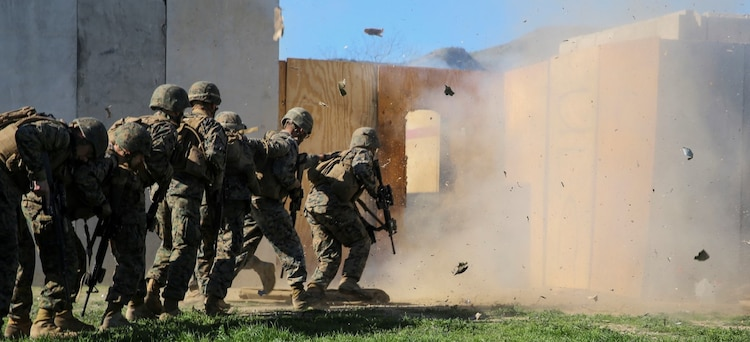 MARINE CORPS BASE CAMP PENDLETON, Calif. – Marines rush in to clear a structure after breaching an entryway with an explosive charge during an urban leaders course, Jan. 29, 2016. During the course, Marines learned four different types of charges used to make a safe entrance into an objective. This type of training allows Marines to practice for possible scenarios when they are deployed to combat zones anywhere on the globe. An instructor with 1st Combat Engineer Battalion, 1st Marine Division, taught this portion of the course to infantrymen of 1st MarDiv. (U.S. Marine Corps photo by Pvt. Robert Bliss)