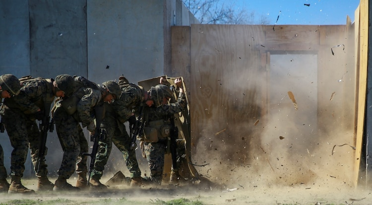MARINE CORPS BASE CAMP PENDLETON, Calif. – Marines shield themselves from a detonated explosive charge during an urban leaders course, Jan. 29, 2016. During the course, Marines learned four different types of charges used to make a safe entrance into an objective. This type of training allows Marines to practice for possible scenarios when they are deployed to combat zones anywhere on the globe. An instructor with 1st Combat Engineer Battalion, 1st Marine Division, taught this portion of the course to infantrymen of 1st MarDiv. (U.S. Marine Corps photo by Pvt. Robert Bliss)