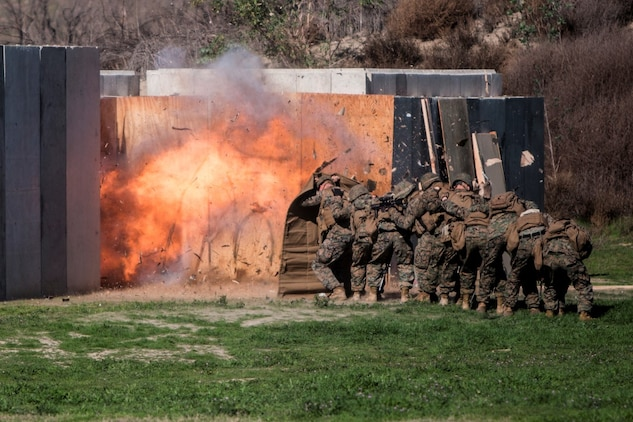MARINE CORPS BASE CAMP PENDLETON, Calif. – Marines shield themselves from a detonated explosive charge during an urban leaders course, Jan. 29, 2016. During the course, Marines learned four different types of charges used to make a safe entrance into an objective. This type of training allows Marines to practice for possible scenarios when they are deployed to combat zones anywhere on the globe. An instructor with 1st Combat Engineer Battalion, 1st Marine Division, taught this portion of the course to infantrymen of 1st MarDiv. (U.S. Marine Corps photo by Sgt. Emmanuel Ramos)