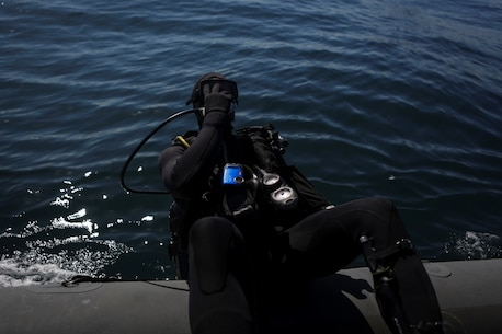 Captain Scott Williams, company commander of Company A, 1st Reconnaissance Battalion, 1st Marine Division, dives out of a rigid-hulled inflatable boat to conduct underwater search operations training, Jan. 28, 2016. The Marines and Sailors of Co. A will use their dive ability to give the 11th Marine Expeditionary Unit a valuable underwater search tool when it deploys later this year.