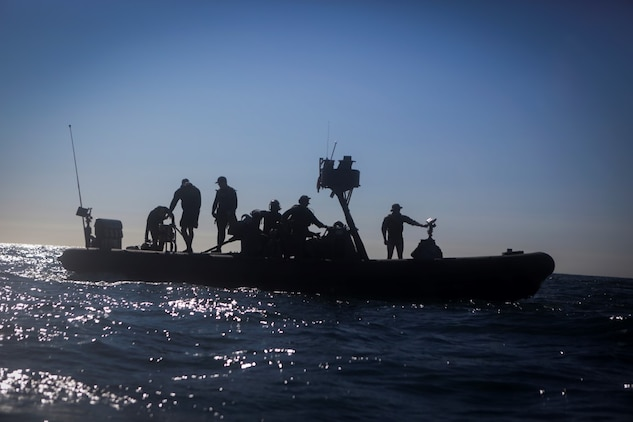 Marines assigned to Company A, 1st Reconnaissance Battalion, 1st Marine Division, and Sailors with Assault Craft Unit One, Naval Beach Group One, wait aboard a rigid-hulled inflatable boat for Marines practicing dive techniques off the coast of California, Jan. 28, 2016. The Marines and Sailors will use their dive ability to give the 11th Marine Expeditionary Unit a valuable underwater search tool when it deploys later this year.