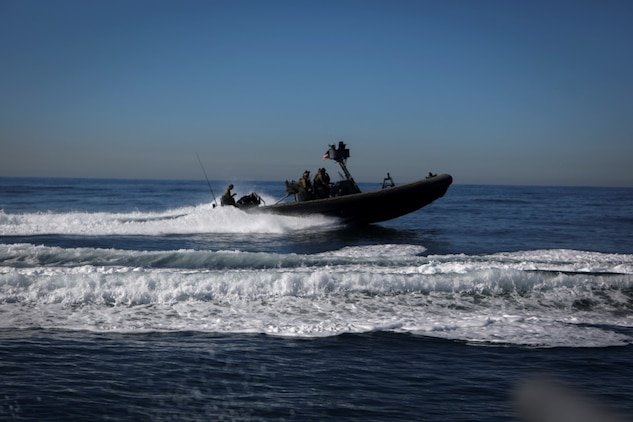 Marines assigned to Company A, 1st Reconnaissance Battalion, 1st Marine Division, and Sailors with Assault Craft Unit One, Naval Beach Group One, maneuver rigid-hulled inflatable boats out of the Dana Landing Marina to conduct dive operations training, Jan. 28, 2016. The Marines and Sailors will use their dive ability to give the 11th Marine Expeditionary Unit a valuable underwater search tool when it deploys later this year.