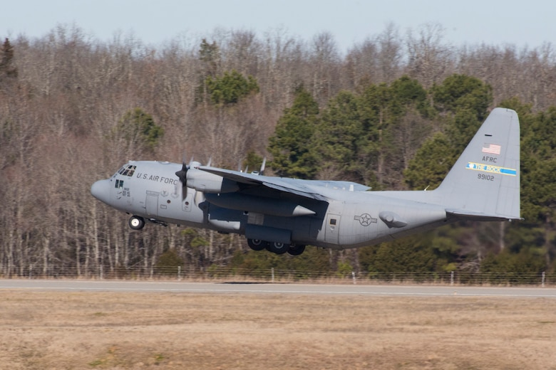 """A U.S. Air Force Reserve C-130H Hercules assigned to the 913th Airlift Group, lifts off the runway at Little Rock Air Force Base on its final mission for the unit Jan. 28, 2016. The aircraft will be moved to a new location soon, as part of the group's transition from the """"H"""" model to the """"J"""" model. (U.S. Air Force photo by Master Sgt. Jeff Walston/Released)"""