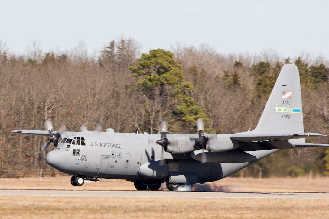"A U.S. Air Force Reserve C-130H Hercules assigned to the 913th Airlift Group, touches down on the runway at Little Rock Air Force Base after its final mission for the unit Jan. 28, 2016. The aircraft is one of the last two that will be moved to a new locations soon, as part of the group's transition from the ""H"" model to the ""J"" model. (U.S. Air Force photo by Master Sgt. Jeff Walston/Released)"